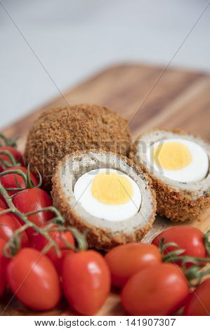 Scotch egg savory snack on a wooden board