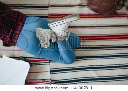 nice brunette girl with tablet lying on the floor.