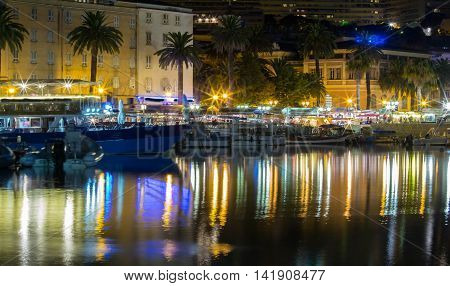 The Ajaccio city at night Corsica island France.