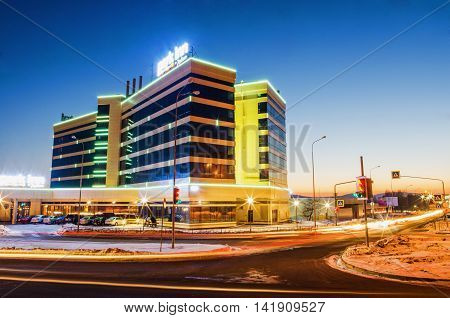 """NIZHNY TAGIL RUSSIA - FEBRUARY 13 2016: The hotel """"Park inn"""" with evening lights at sunset in winter"""