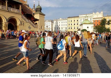 Cracow, Poland, July 25, 2016: Young people dancing on the market square of Cracow in Poland.