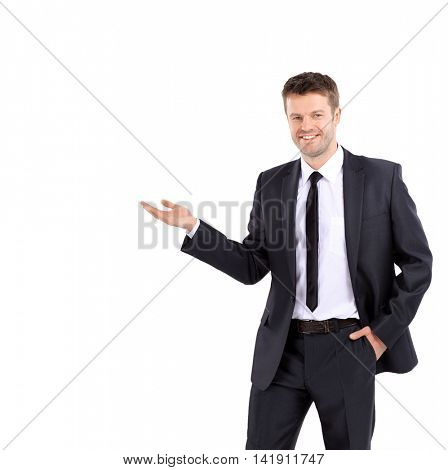 Smiling business man showing open hand palm with copy space for