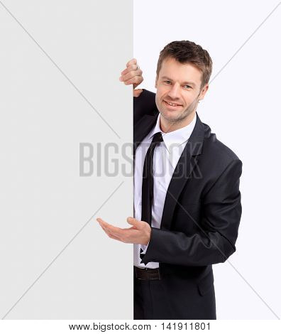 Portrait of businessman pointing at something.