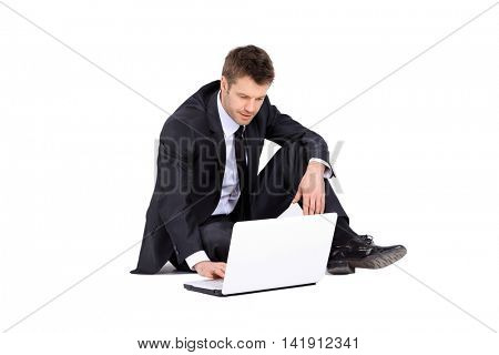 Businessman with laptop isolated on white background