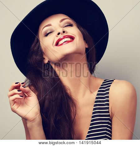 Happy Toothy Laughing Brunette Young Woman In Black Hat With Closed Eyes. Closeup Portrait Of Happin