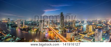 Bangkok Transportation at Dusk with Modern Business Building along the river (Thailand)-Panorama
