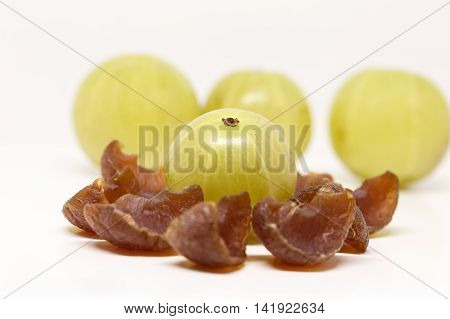 Indian Gooseberry with gooseberry candies in the blurred foreground