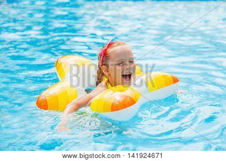 Happy Child Playing In Swimming Pool. Summer Vacation Concept.