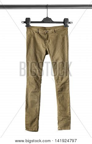Khaki pants on clothes rack isolated over white