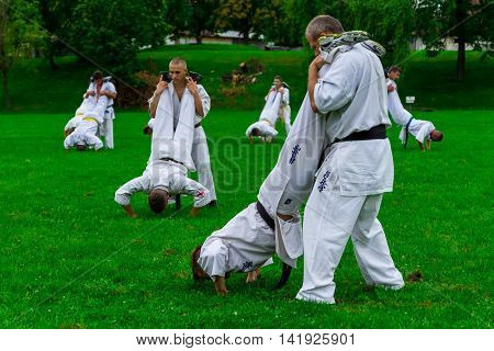Miskolc Hungary - August 2. 2016: Athletes are pressed about supporting partner during the international summer training camp for Kyokushin Karate.