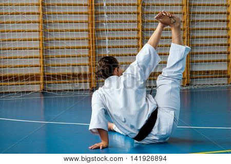 Miskolc Hungary - August 2. 2016: Athlete performs a warm-up during the international summer training camp for Kyokushin Karate.