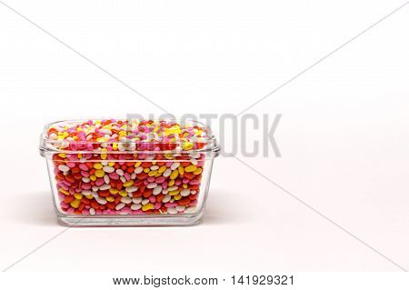 Jeeraka Mithai - a multi-coloured sugar coated Indian traditional sweet also known as Candied cumins or mukhwas and used as mouth freshener in Kerala, India