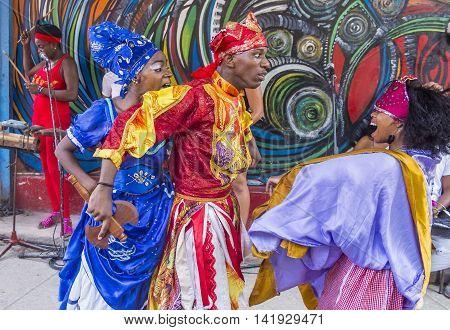 HAVANA CUBA - JULY 18 : Rumba dancers in Havana Cuba on July 18 2016. Rumba is a secular genre of Cuban music involving dance percussion and song. It originated in the northern regions of Cuba