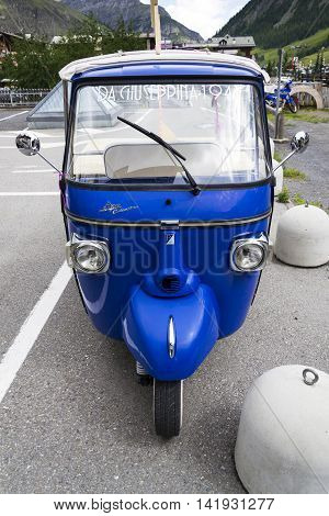 Livigno, Italy - August 1: Limited Edition Model Of Three-wheeled Vehicle Piaggio Ape Calessino Stan