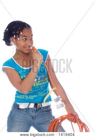 Young Girl Putting Powercable In Her Nose