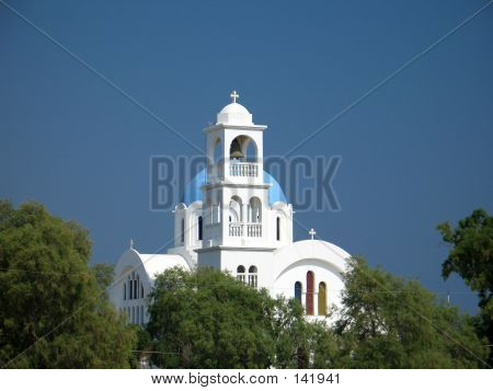 a typical blue and white greek island church at agistri island poster