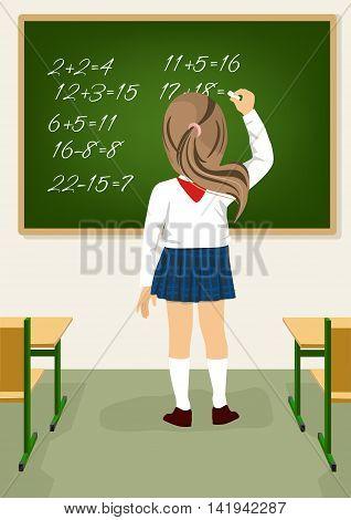 Back view of schoolgirl solving arithmetical on a blackboard