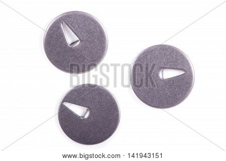 Round metal drawing pins on a white background