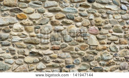 stone and concrete wall, color rocks fieldstone texture background