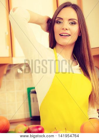 Health nature cuisine diet concept. Gorgeous cook preparing dish Younf girl wearing apron in kitchen making healthy food out of fruits. poster