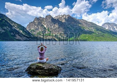 Yoga by nature. Jenny Lake in Grand Tetons National Park Jackson Wyoming.