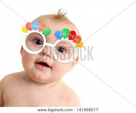 Baby wearing Happy Birthday glasses.