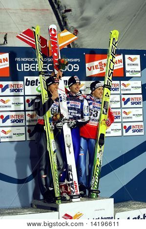 LIBEREC-FEBRUARY 21:Schlierenzauer Gregor of Austria, Loitzl Wolfgang of Austria, Ammann Simon of Switzerland in the FIS Nordic World SKI Championships February 21, 2009 in Liberec, Czech Republic.