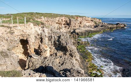 ROCKINGHAM,WA,AUSTRALIA-JUNE 12,2016: Person jogging the limestone coast with Indian Ocean views at Point Peron in Rockingham, Western Australia