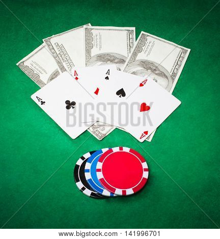 Poker cloth, a deck of cards and chips. Background.