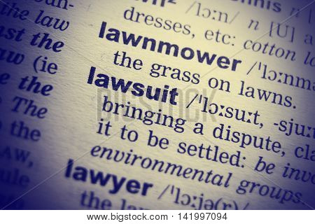 Dictionary definition of the word lawsuit. Close-up shot.