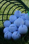 Several practice golf balls in golf bucket. poster