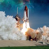 Space Shuttle Discovery launches from NASA Kennedy Space Center Launch Pad. Elements of this image furnished by NASA. poster