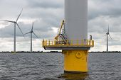 Foundation big Dutch wind turbine in the sea poster