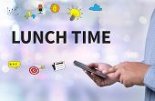 LUNCH TIME person holding a smartphone on blurred cityscape background poster