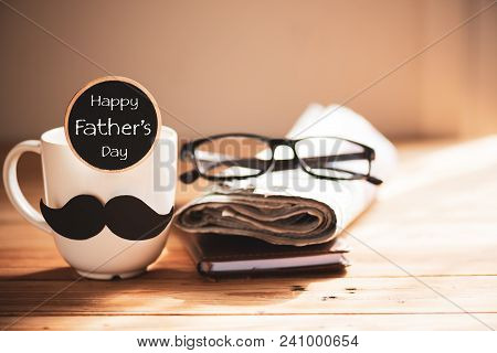 Happy Fathers Day Concept. Coffee Cup With Black Paper Mustache, Wooden Tag With  Happy Father's Day