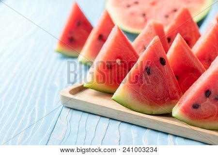 Slice Of Watermelon On Blue Wood Background, Fruit In Summer Concept