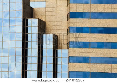 Geometric Facade Glass Windows With Sky Reflected And Architecture Of A Modern Office Building, Cons