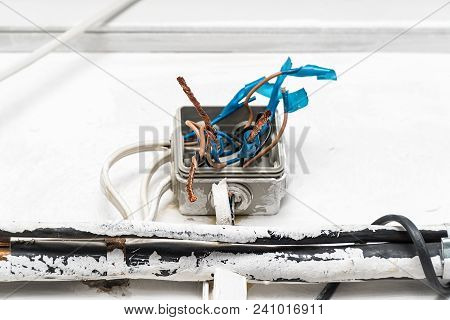 Hazard electrical wiring. Exposed wire in the electrical wiring in the wall poster