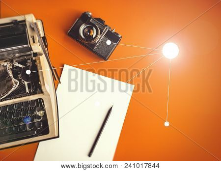Typewriter, Vintage Film Camera, Sheet Of Paper And Pencil On A Yellow Background, Top View With Sun