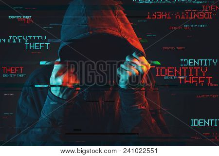Online Identity Theft Concept With Faceless Hooded Male Person, Low Key Red And Blue Lit Image And D