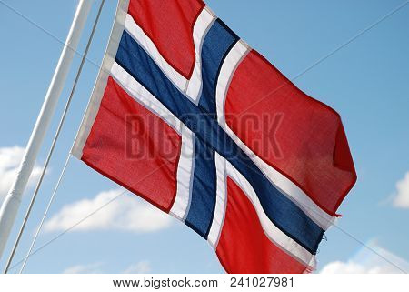 A Norwegian Flag Floating In The Wind