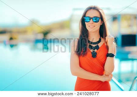 Trendy Woman Wearing Statement Necklace And Sun Glasses By The Pool