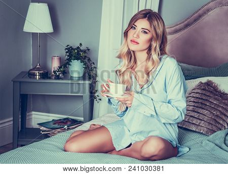 Beautiful Woman In Bed With Cup Of Coffee. Pensive Young Woman. Coffee In Bed. Morning Coffee