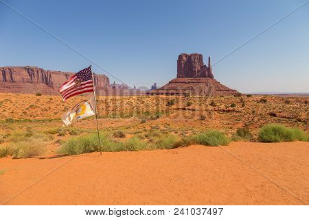 View East Mitten Butte With Flags. Navajo Tribal Park Of Monument Valley, Utah, Arizona, Usa