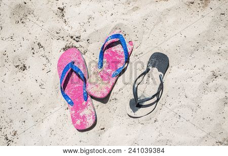 Flip-flop On The Beach In The Sand
