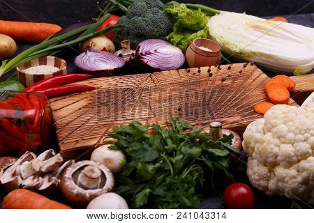 Vegetables On Black Background. Bred In The Middle. Tomatoes Peppers Green Cucumber Onion Mushrooms.