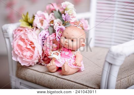 Girl Doll With Pink And Violet Flowers. The Fashion Concept.