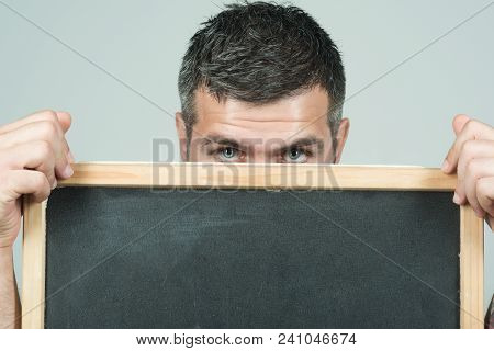 Business Or Advertising Concept - Attractive Man Holds Black Board, Ready For Your Text, Advertising