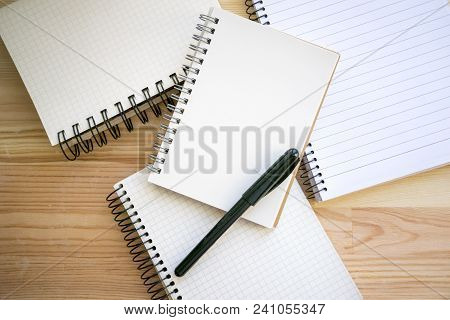 Top View Of Notebooks With Empty Pages Having Lines And Squares. Notepad With Metallic Binder Black