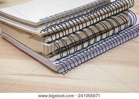 Close Up Of Memo Pads With Different Size Bundles. Office Helpers On Round Clips. Notebooks Collecti
